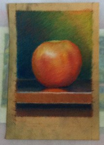 Apple pastel on tan paper